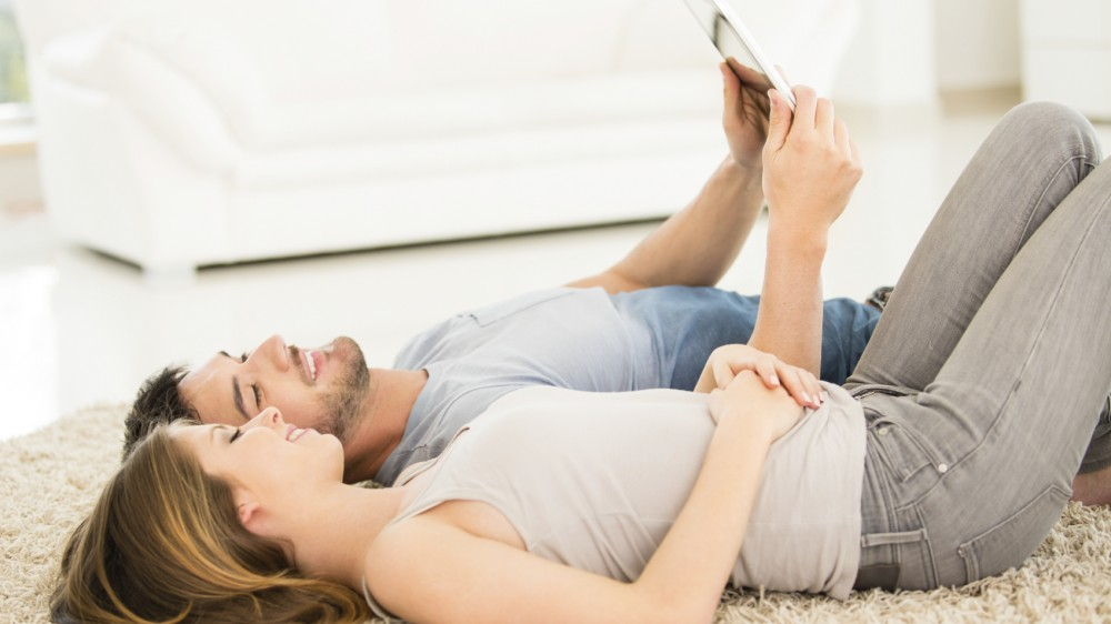 couple using tablet for home DNA test review