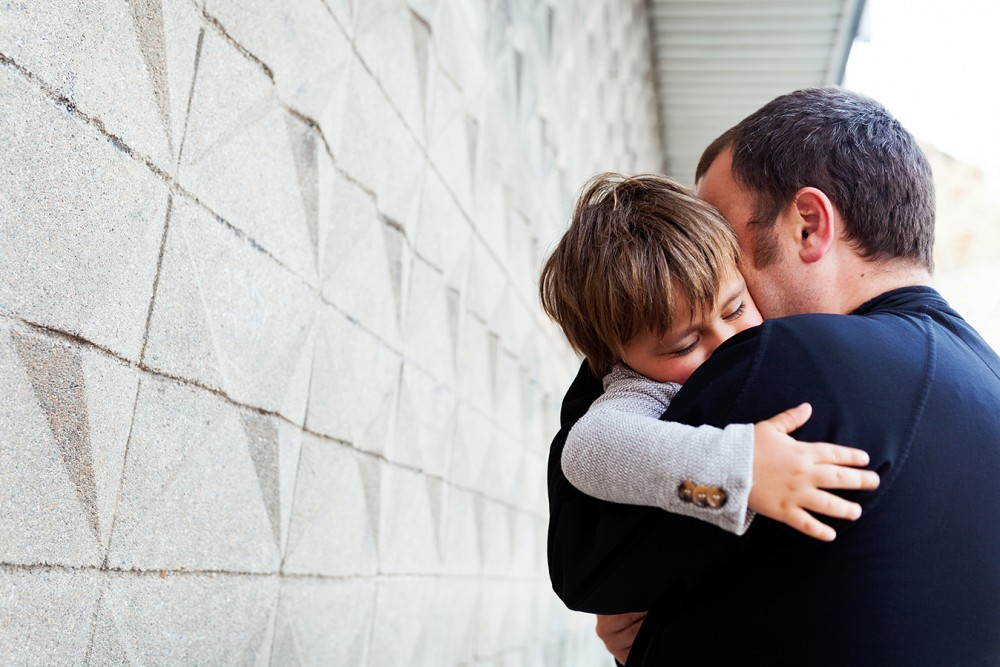 FATHER HUGGING SON AFTER A PATERNITY TEST